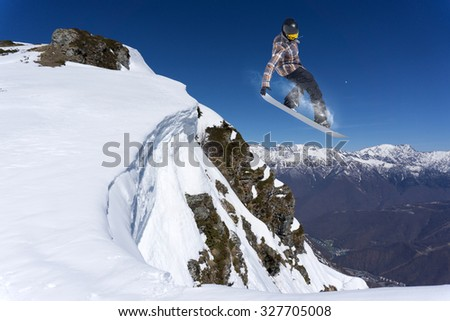 Flying snowboarder on mountains, extreme sport #327705008