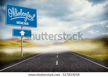 Oktoberfest graphics against blue sign by road #327823058