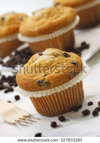 Plumcake with chocolate drops on whithe wooden table #327833285