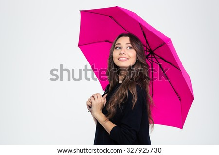 Portrait of a smiling beautiful woman holding umbrella and looking up isolated on a white background #327925730