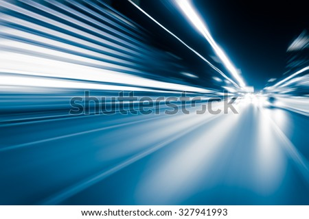 Abstract speed motion in highway road tunnel, blurred motion toward the central #327941993