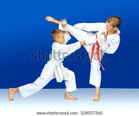 Children in karategi are training karate blows #328037360
