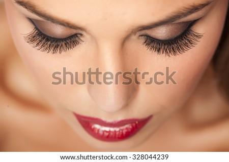Makeup and artificial eyelashes Royalty-Free Stock Photo #328044239