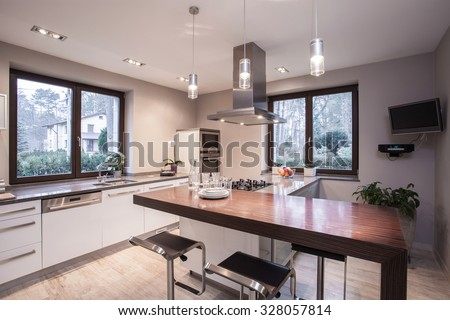 Light and modern kitchen in the house  #328057814