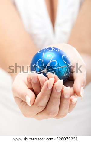 Woman holding blue Christmas ball decoration, isolated on white background #328079231