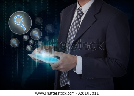 Businessman hand touch search icons on a tablet #328105811