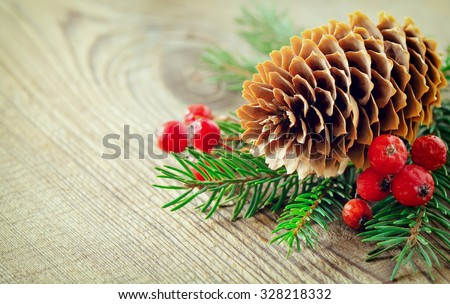 Christmas vintage background, pine cone and winter berries in a bunch of coniferous branches, stylized photo #328218332