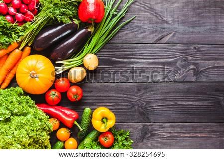 Background of wooden planks black color with fresh vegetables. #328254695