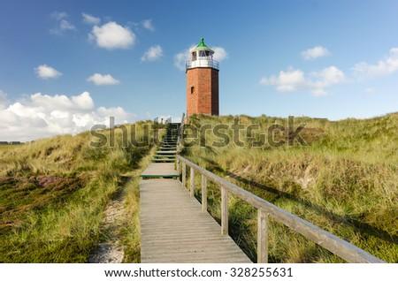 Lighthouse at Kampen, Sylt, Schleswig-Holstein, Germany #328255631