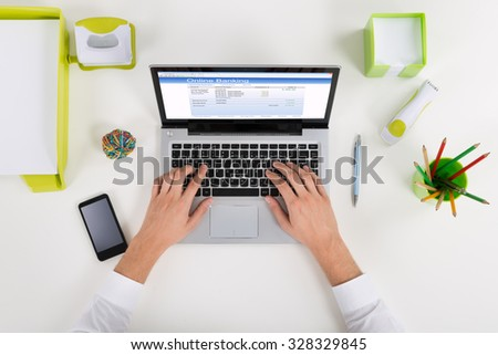 High Angle View Of Businessperson Banking Online On Laptop At Desk #328329845