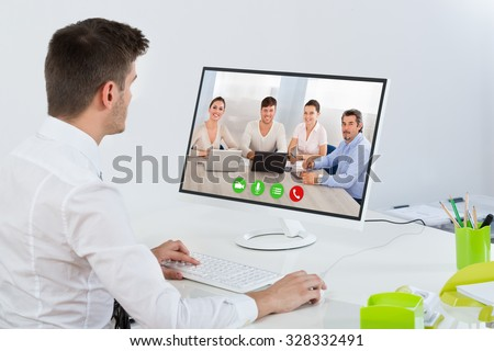 Young Businessman Videoconferencing With Colleagues On Computer #328332491
