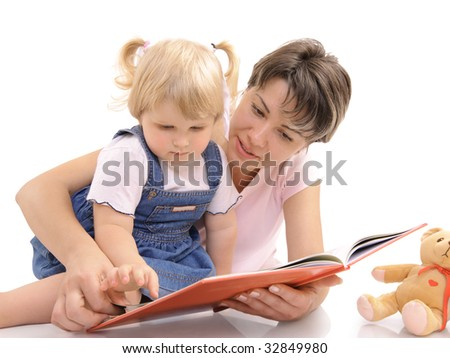 Young mother looking at books together with her little daughter