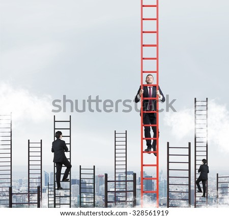 A concept of competition, and problem solving. Several businessmen are racing to achieve the highest point using ladders. New York city view. Royalty-Free Stock Photo #328561919