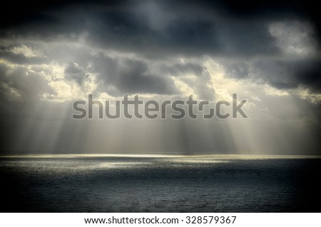 Seascape-Sun rays shining through the clouds and reflected in the sea.HDR image #328579367