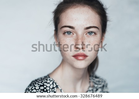 face of a beautiful young girl with a clean fresh face close up #328676489