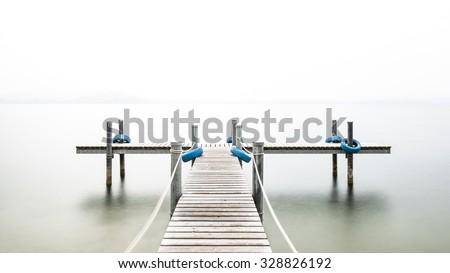 Wooden pier on the lake. Fog. Long exposure #328826192