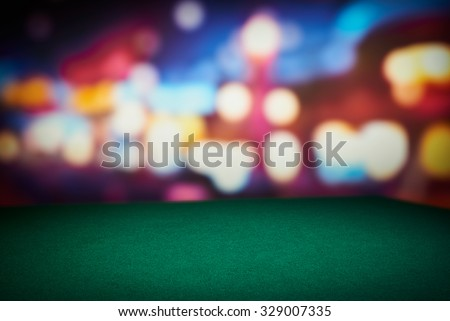 Poker green table in casino with blur background Royalty-Free Stock Photo #329007335