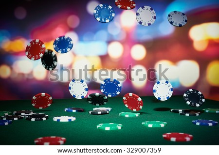 Poker chips on table in casino Royalty-Free Stock Photo #329007359