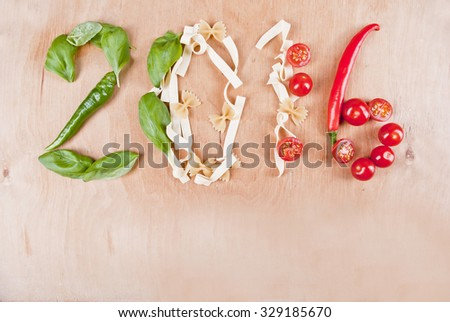 Year 2016 shape made of fresh ingredients peppers, basil, pasta and tomatoes, concept. #329185670