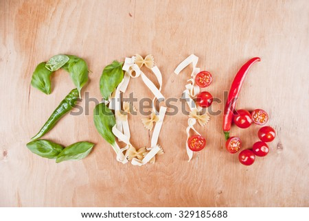 Year 2016 shape made of fresh ingredients peppers, basil, pasta and tomatoes, concept. #329185688