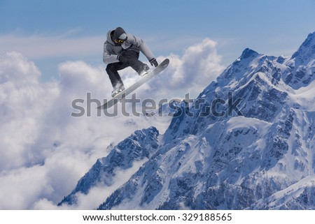 Flying snowboarder on mountains, extreme sport #329188565