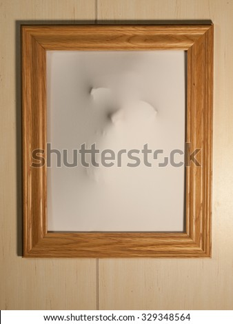 Creepy Picture Frame with Something Coming Out of It #329348564