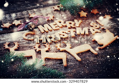 Card with Gingerbread Cookies. Baked Letters Merry Christmas, Bell, Fir Tree, Figures of Deers, Sledge, Stars. Toned #329407829
