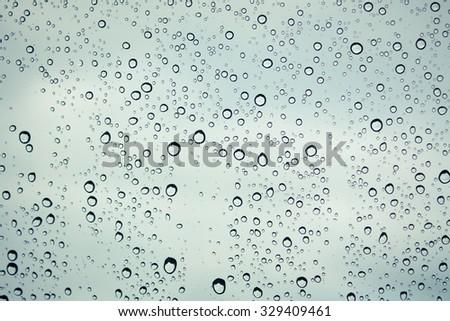 Drops of rain on glass , rain drops on clear window #329409461