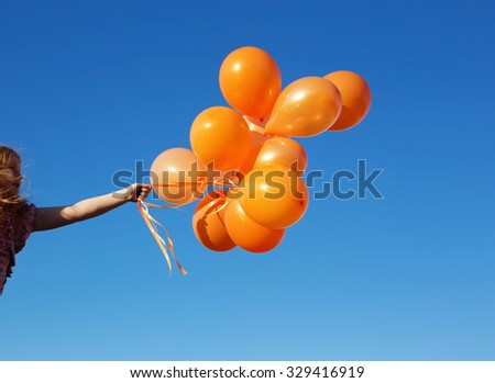 little girl outdoors with balloons #329416919