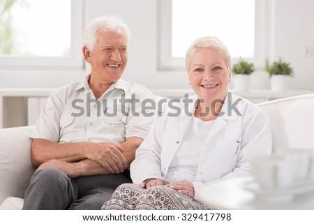 Old man is looking at his nurse  #329417798