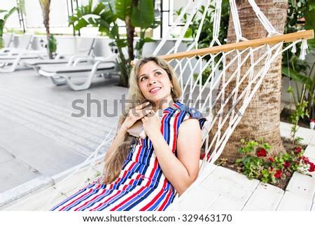 Happy girl resting in hammock #329463170