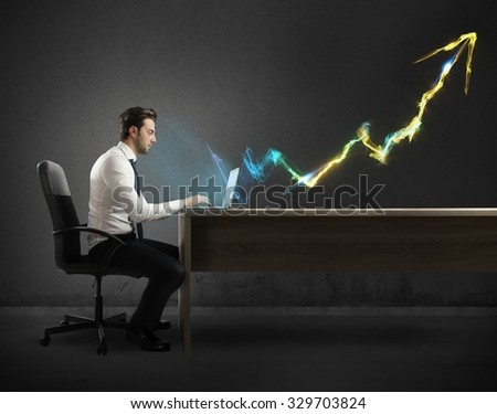 Businessman working at computer with light arrow Royalty-Free Stock Photo #329703824