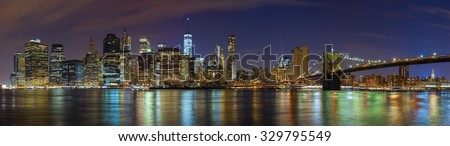 Manhattan skyline at night, New York City panoramic picture, USA.