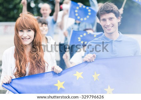 Picture of young community workers with european union flags #329796626