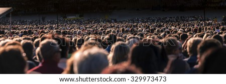 Panoramic photo of large crowd of people. Slow shutter speed motion blur. #329973473