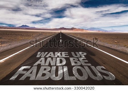 Wake Up and Be Fabulous written on desert road