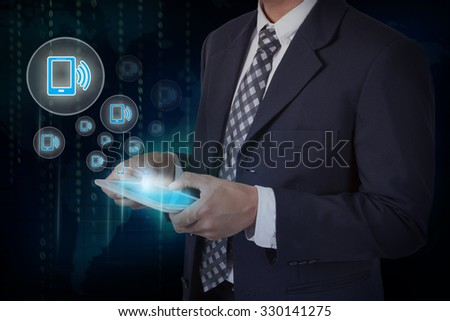 Businessman hand touch screen smartphone icons on a tablet. internet and technology concept. #330141275