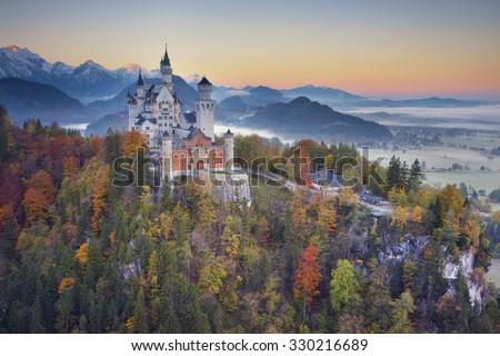 Neuschwanstein Castle, Germany. View of Neuschwanstein Castle during foggy autumn twilight. #330216689