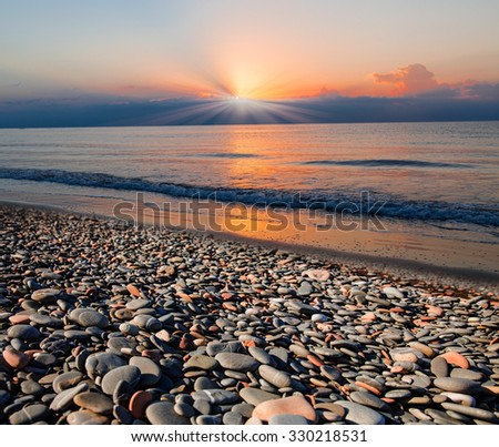 Stones on beach and sea water #330218531