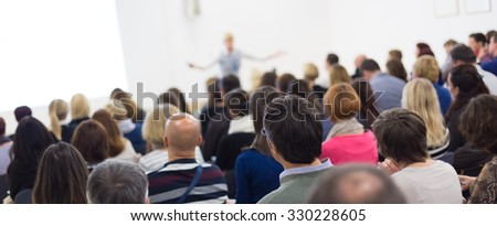 Speaker Giving a Talk at Business Meeting. Audience in the conference hall. Business and Entrepreneurship. Panoramic composition suitable for banners. #330228605