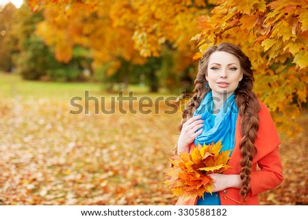 Autumn model, bright make up. woman on background fall landscape leaves of trees. Girl Model on autumn season. Fashion people. #330588182