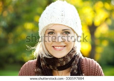 Beautiful girl smiling and enjoying autumn sunshine. #330597884