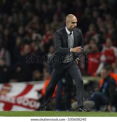 LONDON, ENGLAND - OCTOBER 20 2015: The UEFA Champions League match between Arsenal and Bayern Munich at The Emirates Stadium on October 20, 2015 in London, United Kingdom. #330608240