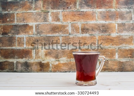 A Cup of tea on the wooden #330724493