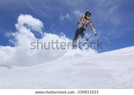 Flying snowboarder on mountains, extreme winter sport #330811031
