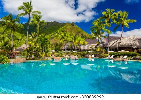 Swimming pool and houses of tropical resort on Moorea, Tahiti #330839999