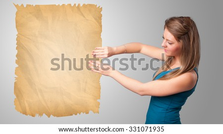 Beautiful young girl presenting old paper copy space #331071935