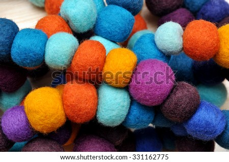 Colorful balls of wool. Colorful felt balls. Dried balls of wool. Colored beads. Felt handmade. Necklace with colorful beads #331162775