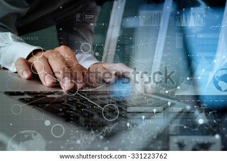 Close up of business man hand working on blank screen laptop computer on wooden desk as concept #331223762