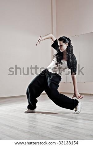 attractive breakdancer in motion. photo in dance studio